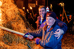The Biggar Hogmanay bonfire lit at 9.30pm on Hogmanay by local resident Bobby Boyd MBE (R) with BIggar Cornet Allan Bartholomew.<br /> <br /> This is probably the biggest new year bonfire anywhere in the UK and continues a tradition going back hundreds of years.<br /> <br /> <br /> (c) Andrew Wilson | Edinburgh Elite media
