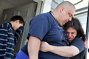Hours after hearing the devastating news, Joseph Michael Ford Sr. and his two sons, Tyler Ford, left, and Joseph Ford Jr. try to deal with the loss of Mr. Fords other son Lance Cpl. Michael Ford a Marine that was killed in Iraq when the tank he was driving ran over an explosive devise.