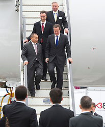 © London News Pictures. 09/07/2012. Farnborough, UK. British Prime Minister David cameron leaving a Malaysian Airlines A380 Airbus with Ahmad Jauhari Yahya CEO of Malaysia Airlines (front left) during a walk round of aircraft on day one of the Farnborough International Airshow, in Farnborough, Hampshire, UK on July 9, 2012. FIA is a seven-day international trade fair for the aerospace industry which is held every two years at Farnborough Airport . Photo credit: Ben Cawthra/LNP.