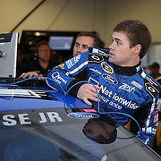 Racecar driver Ricky Stenhouse Jr. is seen entering his car  in his garage area during the  56th Annual NASCAR Daytona 500 practice session at Daytona International Speedway on Wednesday, February 19, 2014 in Daytona Beach, Florida.  (AP Photo/Alex Menendez)