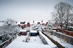 Snow covered terraced houses, gardens and sheds, Bearwood, Birmingham, West Midlands, England, UK.
