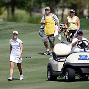 """MOUNT PLEASAT, SC, May 31, 2007: MacKenzie """"Mac"""" Kline is a young girl with a heart ailment who requires oxygen when playing golf. She was invited to play in her first professional tournament on May 31, 2007 at the Ginn Hosted by Annika in Mt. Pleasant, South Carolina. She can be seen putting an oxygen tube in her nose while being allowed an exemption to use a cart at the LPGA tournament. (Photography by Todd Bigelow/Aurora)"""