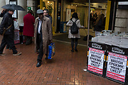 As the Coronovirus pandemic takes hold across the UK, with health authorities reporting cases rising from 25 to 87 in a single day, and resulting in the UKs chief medical officer Prof Chris Whitty announcing that an epidemic in the UK was highly likely, Londoners pass-by Evening Standard headlines outside Embankment Underground station, on 4th March 2020, in London, England.