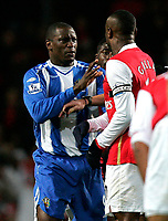 Photo: Tom Dulat/Sportsbeat Images.<br /> <br /> Arsenal v Wigan Athletic. The FA Barclays Premiership. 24/11/2007.<br /> <br /> Emile Heskey of Wigan Athletic pushes away William Gallas of Arsenal.