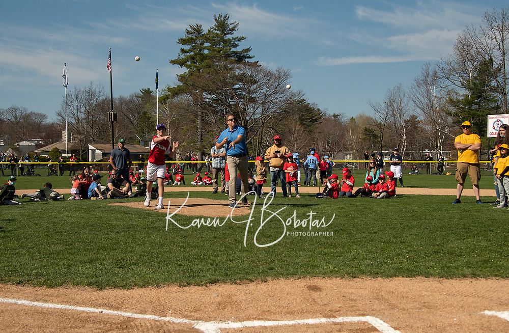 """Carter Jones """"Mr. Little League"""" from 2019 shares the honor with Governor Chris Sununu on the mound at Colby Field to throw out the first pitch in celebration of opening day for Laconia Little League on Saturday.  (Karen Bobotas Photo/for The Laconia Daily Sun)"""