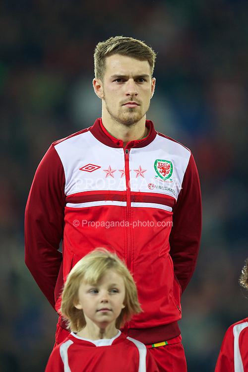 CARDIFF, WALES - Friday, October 11, 2013: Wales' captain Aaron Ramsey lines-up to face Macedonia before the 2014 FIFA World Cup Brazil Qualifying Group A match at the Cardiff City Stadium. (Pic by David Rawcliffe/Propaganda)