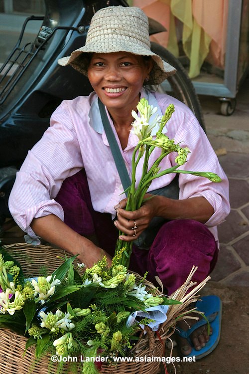 Florist at the Siem Reap Morning Market  - a large array of indoor & outdoor stalls selling a huge variety of items and goods.  The market starts up at sunrise and remains open until around midday.