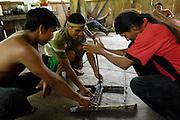 Ecuador, May 6 2010: Making fire the Huaorani way. Copyright 2010 Peter Horrell