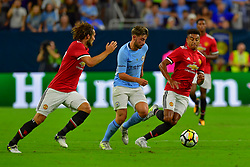 Manchester United midfielder Jesse Lingard (14) and Manchester City midfielder Patrick Roberts battle for possession during the International Champions Cup match between Manchester United and Manchester City at NRG Stadium in Houston, Texas