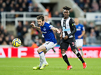 Football - 2019 / 2020 Premier League - Newcastle United vs. Everton<br /> <br /> Leighton Baines of Everton vies with Christian Atsu of Newcastle United, at St James' Park Stadium.<br /> <br /> COLORSPORT/BRUCE WHITE