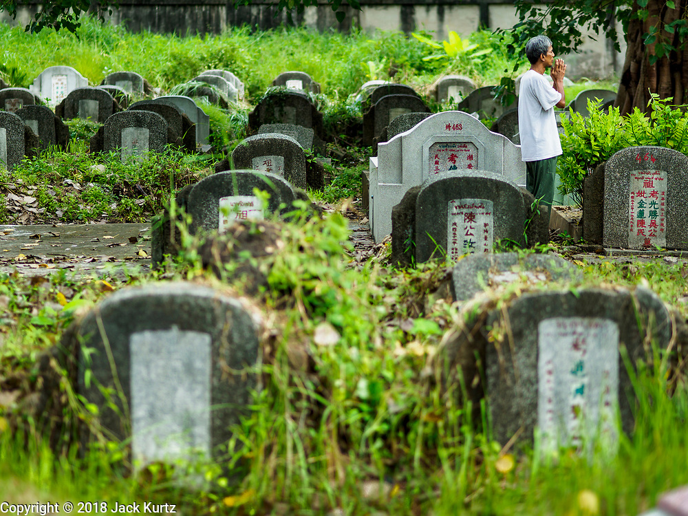30 AUGUST 2018 - BANGKOK, THAILAND: A man prays in Tae Chio Cemetery in Yan Nawa District of Bangkok. It is a cemetery for Bangkok's Chinese community.     PHOTO BY JACK KURTZ