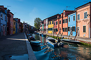 VENICE, ITALY - APRIL 2018. <br /> Sebastiano, one of the fishermen that makes Fishing Tourism, lives in the island of Burano, from where he starts with his boat to take the boat to carry the tourists. The island of Burano is a pearl of the Venetian lagoon. It is well known for its colored houses and the traditional art of making laces, that are, also, a Unesco heritage.