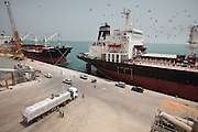Liberty Star and Liberty Spirit are lined up in the old port of Djibouti. The US freighters import 130,000 tonnes of wheat, under the auspices of the WFP; from here, supplies go out to Djibouti, Northern Somalia and, most importantly, Ethiopia.  At the Port, loading bags of Sorghum and Wheat to fight famine in Ethiopia. Brought on ships, these are donations of the USA via the World Food Program (WFP). The bags are loaded onto trucks bound to Ethiopia. 95% of the traffic going through the port goes to neighboring Ethiopia who does not have any coastline...The geostrategical and geopolitical importance of the Republic of Djibouti, located on the Horn of Africa, by the Red Sea and the Gulf of Aden, and bordered by Eritrea, Ethiopia and Somalia.
