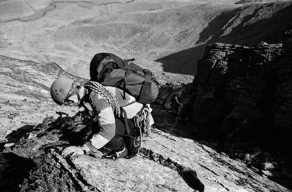 Placing gear on Atlantic Slab in the Ogwen Valley, North Wales