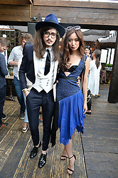 JOSHUA KANE and BETTY BACHZ at the Warner Music Group Summer Party in association with British GQ held at Shoreditch House, Ebor Street, London E2 on 8th July 2015.