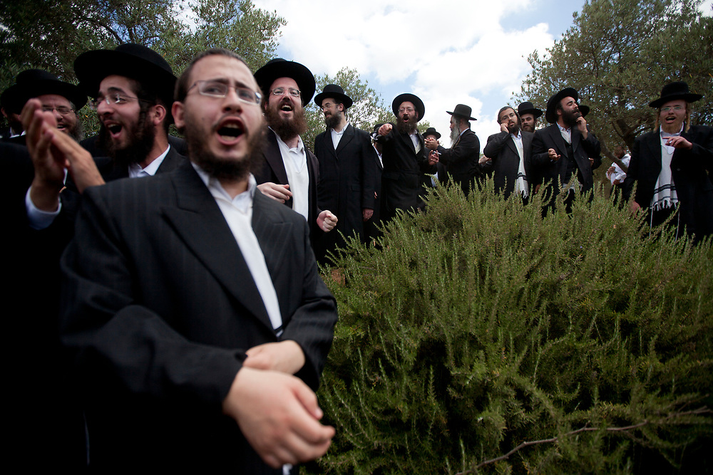 Ultra-Orthodox Jewish men dance and celebrate outside the Supreme Court in Jerusalem, on June 27, 2010, following a decision to free a group of Ashkenazi parents which refused the integration and were sent to jail at the end of a discussion regarding the segregation between Ashkenazi and Sephardic Jewish girls at the Beit Yaakov school in Immanuel.