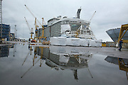 Oasis of the Seas at the shipyard in Turku, Finland where she is being built..Photos show Royal Caribbean's latest  ship 2 months before completion. ..The ship reflected in a puddle of water after a rain storm.