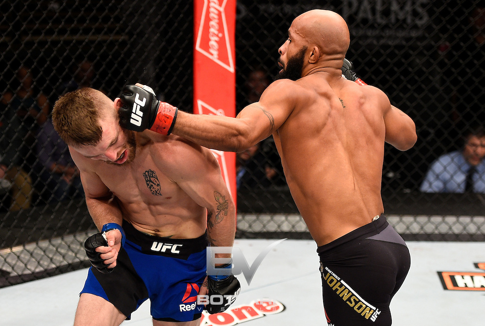 LAS VEGAS, NV - DECEMBER 03:  (R-L) Demetrious Johnson punches Timothy Elliott in their flyweight championship bout during The Ultimate Fighter Finale event inside the Pearl concert theater at the Palms Resort & Casino on December 3, 2016 in Las Vegas, Nevada. (Photo by Jeff Bottari/Zuffa LLC/Zuffa LLC via Getty Images)
