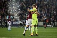 Joe Hart and Andy Carroll of West Ham United hug. Premier league match, West Ham Utd v Huddersfield Town at the London Stadium, Queen Elizabeth Olympic Park in London on Monday 11th September 2017.<br /> pic by Kieran Clarke, Andrew Orchard sports photography.
