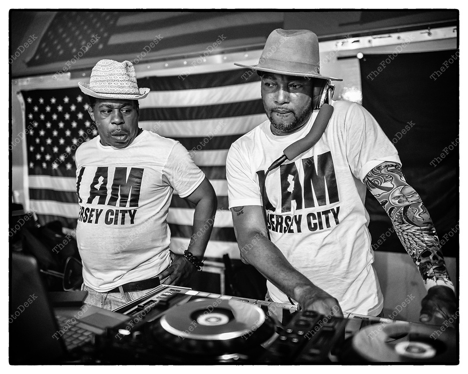 JERSEY CITY, NEW JERSEY:  MC RasAnthony and DJ Ricky Clark work the crowd and  turn tables during the Jersey City House Music Festival at Lincoln Park, in Jersey City, NJ on Saturday, July 24, 2021.  (Brian Branch-Price/TheFotodesk).