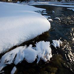 The Ottauquechee River in winter in Quechee, Vermont.