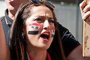 Demonstration against any intervention in Syria called by Stop the War and CND, August 30th 2013, Central London. Young Syrian woman with flag painted on her cheek