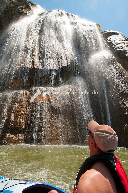 Kayaking below Shoshone Falls a large waterfall on the Snake River in Twin Falls, Idaho.