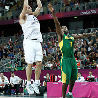 31 July 2012: Great Britain Nate Reinking takes a jumpshot over Brazil Larry Taylor during 67-62 Team Brazil victory over Team Great Britain, during the men's basketball preliminary, at the Basketball Arena, in London, Great Britain.