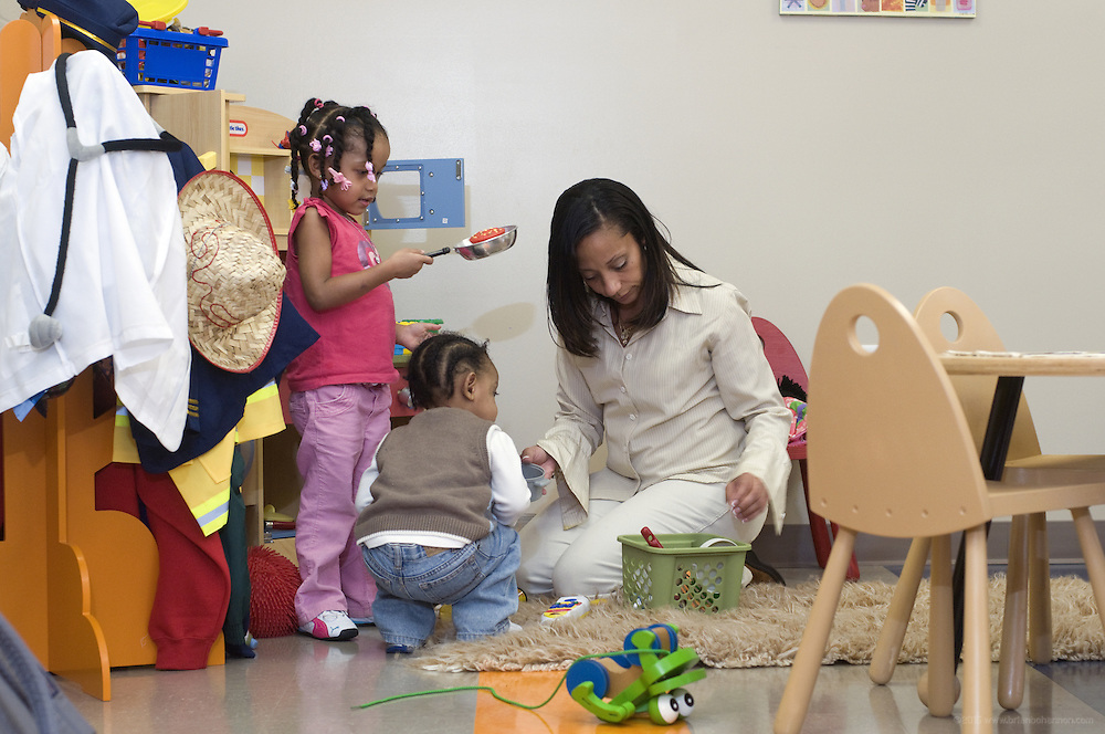 Kema Jamal spends time with her children, 3-year-old daughter Nevaeh Williams, and 21-month-old son Anthoneil Williams, II, in the play room at the women's facility. The first women's facility opened in 1996 on Oak Street. Earlier this year, a state-of-the-art building was constructed for women on 15th Street. (Photo by Brian Bohannon)