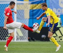 July 3, 2018 - Saint Petersburg, Russia - Viktor Claesson (R) of Sweden national team and Granit Xhaka of Switzerland national team vie for the ball during the 2018 FIFA World Cup Russia Round of 16 match between Sweden and Switzerland on July 3, 2018 at Saint Petersburg Stadium in Saint Petersburg, Russia. (Credit Image: © Mike Kireev/NurPhoto via ZUMA Press)