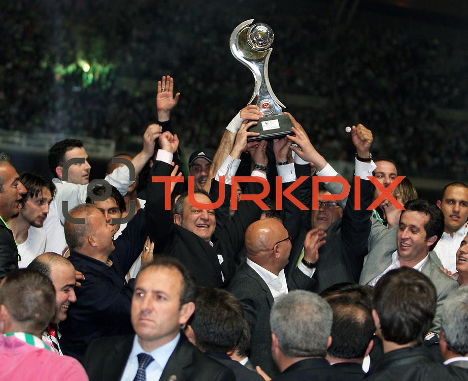 Konyaspor's players celebrate with the BankAsya Cup trophy Soccer during their Turkish soccer Play Off final match Altayspor between Konyaspor at Ataturk Olympic Stadium in Istanbul Turkey on Sunday, 23 May 2010. Photo by TURKPIX