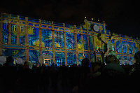 """LYON, FRANCE - DECEMBER 07:Festival of Lights on December 7, 2013 in Lyon. <br /> Place des Terreaux<br /> Spectacular light works by 120 designers will be on show over four days along will attract some three million visitors to the historic city.<br /> In france, each year on December 8, The Festival of Lights expresses gratitude toward Virgin Mary<br /> According to the people, the Festival of Lights celebrates Mary who stopped plague in 1643. The municipal councillors (échevins) had promised to pay tribute to Mary if she saved the town<br /> Since this year, a solemn procession makes its way to the Basilica of Fourvière to candles light and gives offerings in the name of Mary. <br /> This lyonnaise tradition dictates that everyone places candles outsides on all the windows to produce a spectacular effect throughout the streets. Each year, over 4 million tourists come to Lyon for this event.<br /> This festival is probably one of the three biggest festive gatherings in the world in terms of attendance.<br /> And through time, this act of faith in Lyon has been perpetuated by all families and in all religions.<br /> <br /> It is a gesture of joy and gratitude.<br /> Nothing obliges people of Lyon to put these small candles but many of them, away from home, in Paris, Rome, Hong Kong or New York, on December 8, will put in a glass a piece of candle on the edge of their windows, and will think """"I'm from Lyon too.""""<br /> Bruno Vigneron/Getty Images)"""