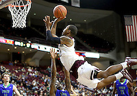 Florida Gulf Coast University's Zach Johnson (5) draws a charging foul from Texas A&M's Anthony Collins (11) during a NCAA college basketball game in College Station, Texas, Wednesday, Dec. 2, 2015. Texas A&M's Anthony Collins (11) fouls  (AP Photo/Sam Craft)