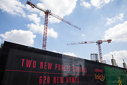 London, UK. 5th June, 2021. Construction cranes are pictured above the Hallsville Quarter in Canning Town. Hallsville is a mixed use town centre development forming part of the Canning Town & Custom House Regeneration Masterplan and comprising 620 new homes as well as retail, workspace and public spaces.