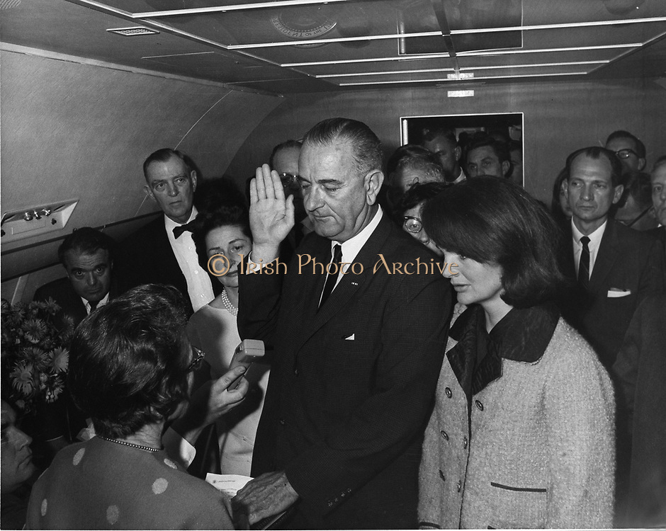 Swearing in of Lyndon Baines Johnson (1908-1973) as 36th President of the United States, 22 November 1963. The ceremony took place on Air Force One, Love Field, Dallas, Texas.  At his side is Jackie Kennedy, widow of the assassinated president, John F Kennedy. LBJ Library, photo by Cecil Stoughton.