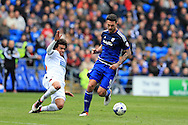 Sean Morrison of Cardiff city ® goes past Derik Osede of Bolton. Skybet football league championship match, Cardiff city v Bolton Wanderers at the Cardiff city Stadium in Cardiff, South Wales on Saturday 23rd April 2016.<br /> pic by Andrew Orchard, Andrew Orchard sports photography.