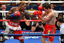 July 29, 2017 - Brooklyn, New York, USA - JERMALL CHARLO (red trunks with white trim) and JORGE SEBASTIAN HEILAND battle in a middleweight bout at the Barclays Center in Brooklyn. (Credit Image: © Joel Plummer via ZUMA Wire)
