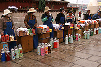 Yak Butter for sale at Barkhor Square, Lhasa - Barkhor Square is an area of narrow streets and a public square located around Jokhang Monastery in Lhasa. <br /> Barkor Square has been the most important devotional circumabulation for Tibetan pilgrims for centuries as it is today. The walk was is about one kilometre long and encircles the entire Jokhang,  Most of the tiny alleys have been demolished in recent years and replaced with wider streets and new buildings by the Chinese government.