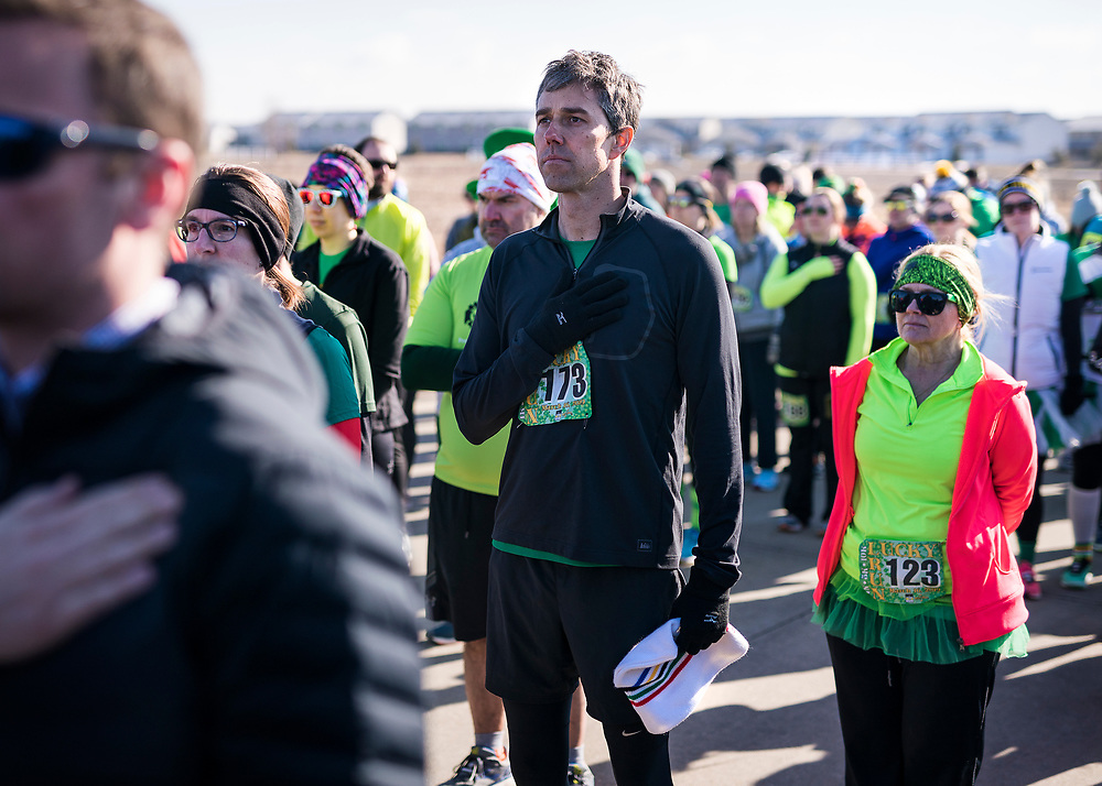 Democratic 2020 presidential candidate Beto O'Rourke, 46, stands for the National Anthem before running a St. Patrick's Day 5K race during a three day road trip across Iowa, in North Liberty, Iowa, U.S., March 16, 2019.  REUTERS/Ben Brewer