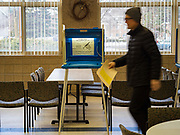 03 MARCH 2020 - MINNETONKA, MINNESOTA: People walk past voting booths to the ballot drop off after voting in the Presidential preference primary in Minnesota on Super Tuesday. Super Tuesday is the biggest presidential primary election day of the US presidential election cycle.    PHOTO BY JACK KURTZ