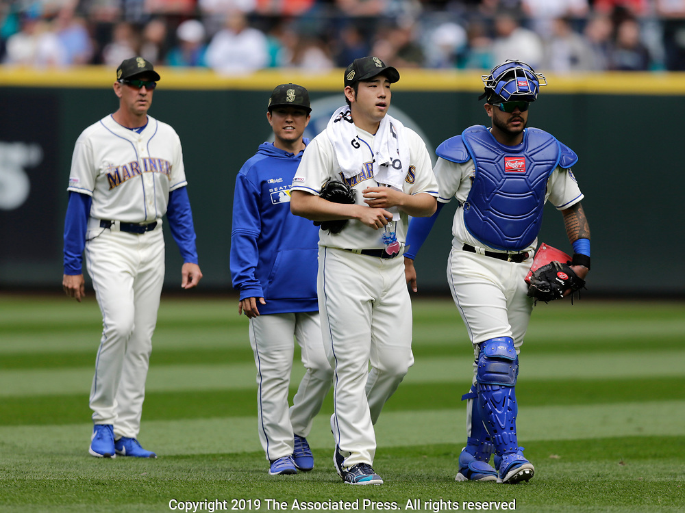 Seattle Mariners starting pitcher Yusei Kikuchi walks with catcher Omar Narvaez from the bullpen before a baseball game against the Minnesota Twins, Sunday, May 19, 2019, in Seattle. The Mariners went on to win 7-4. (AP Photo/John Froschauer)