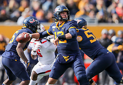 Nov 9, 2019; Morgantown, WV, USA; West Virginia Mountaineers quarterback Austin Kendall (12) throws a pass during the first quarter against the Texas Tech Red Raiders at Mountaineer Field at Milan Puskar Stadium. Mandatory Credit: Ben Queen-USA TODAY Sports