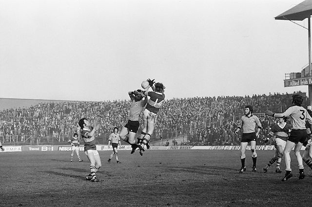 Two player jump high fighting to gain possession of the ball during the All Ireland Senior Gaelic Football Semi Final, Dublin v Kerry in Croke Park on the 23rd of January 1977. Dublin 3-12 Kerry 1-13.