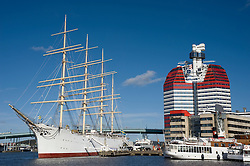 Striking Utkiken Tower  also known as the Lipstick Tower and the Viking sailing ship in Gothenburg Harbour or Lilla Bommen Sweden 2008
