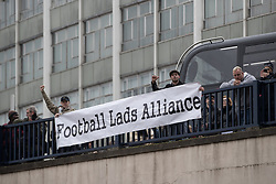 © Licensed to London News Pictures . 24/03/2018. Birmingham, UK. FLA supporters drop a banner from a bridge in Birmingham City Centre during a demonstration by the Football Lads Alliance , against Islam and extremism . Offshoot group, The True Democratic Football Lads Alliance, also hold a separate demonstration . Photo credit: Joel Goodman/LNP