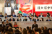 "Staff members man the phone lines for overseas clients during Christie's very first mainland China auction in Shanghai, China September 27,  2013. Both Southeby's and Christie's have opened an office in Mainland China in the past year, however they face overwhelming odds as China's state-owned auction houses such as Poly and Jiamu enjoys a near monopoly over China's art procurement market as foreigners are not allowed to buy vaguely defined ""historical"" art."