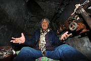 """BEIJING, CHINA - DECEMBER 05: China Out - Finland Out<br /> <br /> Living Underground<br /> <br /> Garbage collector Quan Youzhi, 66, from Henan province, talks to journalists inside an underground utility compartment outside Lidu Park in Chaoyang district on December 5, 2013 in Beijing, China. Four people have been living in some of the compartments there for at least two years, said security guard Wei Zhonghua. """"They usually come to the park to use the restroom around 8 am, and return quite late in the evening. Sometimes they charge their flashlights in the security guard's room,"""" he said. <br /> ©Exclusivepix"""
