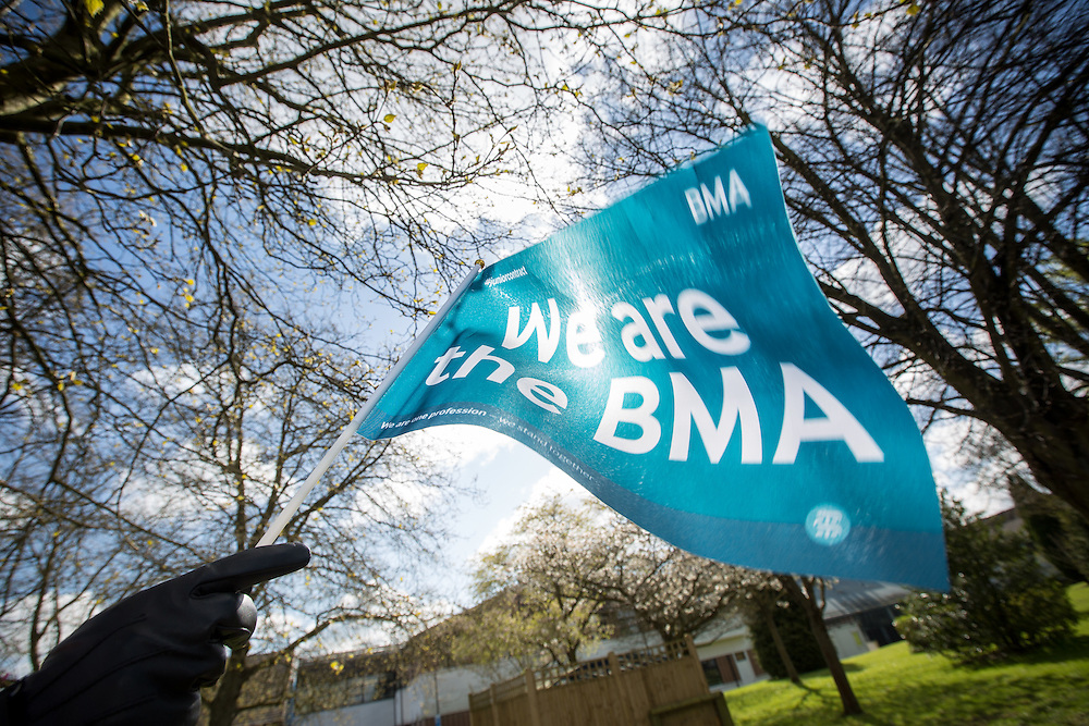 @Licensed to London News Pictures 26/04/2016 Maidstone, Kent. Junior doctors stand outside Maidstone Hospital in Maidstone, Kent today in protest to new contracts with the Conservative government. This is the first of two days of an all-out strike organised by the British Medical Association the first in the history of the NHS.  Photo credit: Manu Palomeque/LNP
