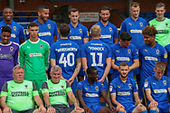 AFC Wimbledon midfielder Mitchell (Mitch) Pinnock (11) and AFC Wimbledon midfielder Anthony Wordsworth (40) looking the wrong way during the official team photocall for AFC Wimbledon at the Cherry Red Records Stadium, Kingston, England on 8 August 2019.