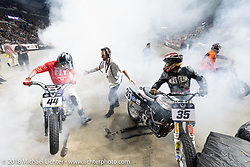 Hooligans Brandon Gonzalez and Dave Kilkenny do a burnout on their Harley-Davidson Sportsters at the end of the Flat Out Friday flat track racing on the Dr. Pepper-covered track in the UW-Milwaukee Panther Arena during the Harley-Davidson 115th Anniversary Celebration event. Milwaukee, WI. USA. Friday August 31, 2018. Photography ©2018 Michael Lichter.